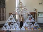 Author Shelley Pearsall stands inside a stage 6 tetrahedron. (image found at http://www.shelleypearsall.com